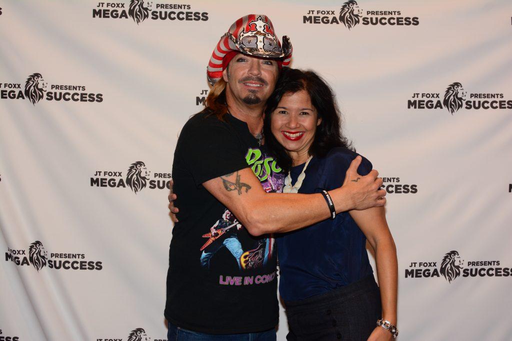 Sandra Fisser with Poison singer Brett Michaels