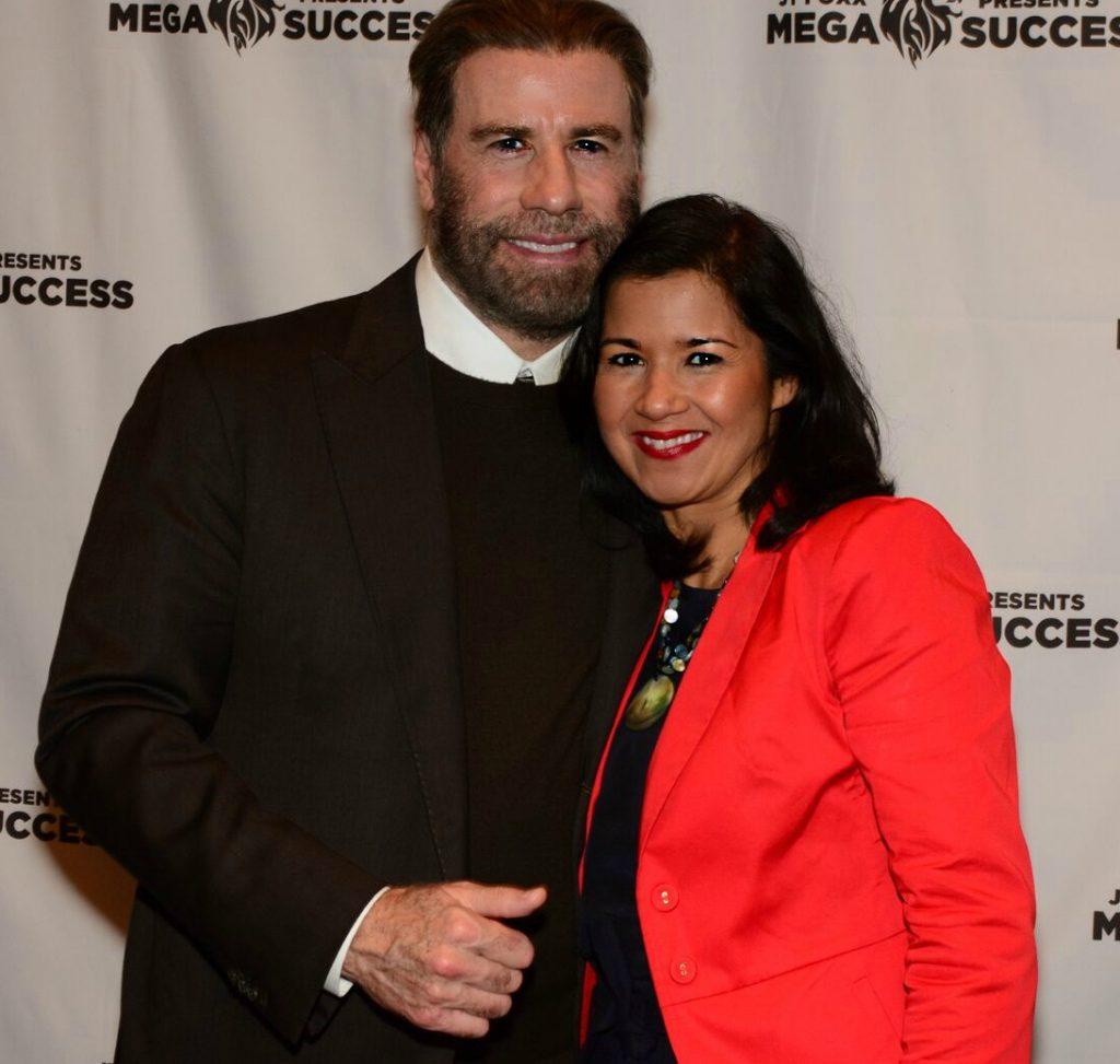 Sandra Fisser with actor and movie producer John Travolta